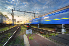 Railway station with blurred modern commuter train Royalty Free Stock Image