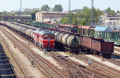 Railway station and cargo train. Narva. Estonia. Landscape in a sunny day Royalty Free Stock Photo
