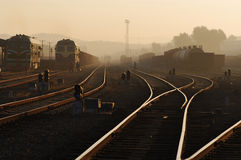 Railway Station in Dawn. Beautuful scene of railway station in dawn, with the burning clouds Royalty Free Stock Photo