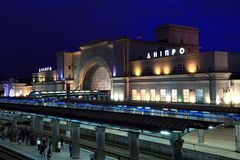 Railway station in Dnipro city with night illumination Dnepropetrovsk, Dnipropetrovsk, Dnepr, Ukraine. The picturesque railway station in Dnipro city at night Stock Photo