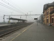 Railway station in fog, Lillehammer, Norway. Royalty Free Stock Images