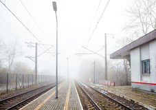 Railway station on foggy day Royalty Free Stock Images