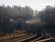 Railway station. A foggy weather near a country railway station Stock Images