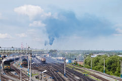 Railway station and gas processing plant on the horizon Royalty Free Stock Image