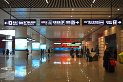 Railway station hall sign. Sign for Exit, Subway, Bus Hub, Parking, Taxi. Beijing South Railway station, reportedly the largest in Asia Royalty Free Stock Photo