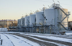 Railway station in the industrial area in winter. Forklifts liquid. Railway station in the industrial area in winter in Moscow. Forklifts liquid Royalty Free Stock Image