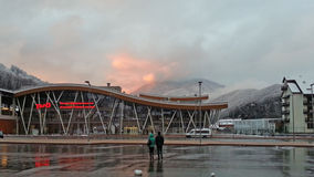 Railway station Krasnaya Polyana, snow mountains. Railway station Krasnaya Polyana, snowy mountains and clouds, winter evening, Sochi, Russia Stock Photo