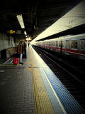 Railway station. Lonely people in Japan Railway Station Royalty Free Stock Photography