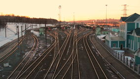 Railway station a lot of lines cargo trains rail freight marshalling yard sunset. Railway yard with a lot of railway lines and cargo trains, rail freight stock video