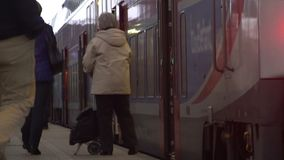 Railway station, male and female tourists leaving and boarding train, traveling. Stock footage stock footage