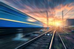Railway station with motion blur effect. Blurred railroad Stock Images