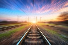 Railway station with motion blur effect. Blurred railroad Royalty Free Stock Photos