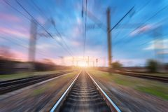 Railway station with motion blur effect. Blurred railroad Stock Photos