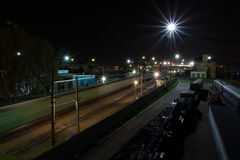 Railway station at night. Railway crane and spare cars will not go . They silently waiting in the wings Stock Photography