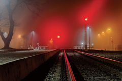 Railway station in the night fog stock photo