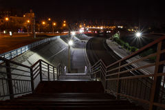 Railway station at night. Light lamps , metal fences and rails . At night, a suburban railway station looks a lot more picturesque than anyone would have thought Royalty Free Stock Photography