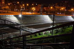 Railway station at night. Light lamps , metal fences and rails . At night, a suburban railway station looks a lot more picturesque than anyone would have thought Royalty Free Stock Photo