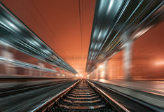 Railway station at night with motion blur effect. Railroad Stock Photography