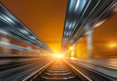 Railway station at night with motion blur effect. Railroad Royalty Free Stock Images