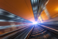 Railway station at night with motion blur effect. Railroad Stock Photos