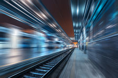 Railway station at night with motion blur effect. Railroad Royalty Free Stock Image