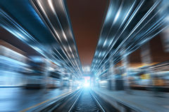 Railway station at night with motion blur effect. Railroad Royalty Free Stock Photos