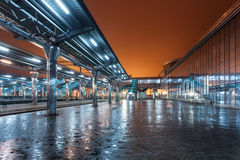 Railway station at night. Train platform in fog. Railroad Royalty Free Stock Images