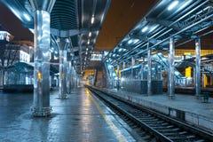 Railway station at night. Train platform in fog. Railroad Stock Photography