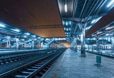 Railway station at night. Train platform in fog. Railroad Stock Photos