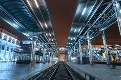 Railway station at night. Train platform in fog. Railroad Royalty Free Stock Photography
