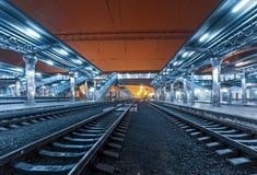 Railway station at night. Train platform in fog. Railroad Royalty Free Stock Image