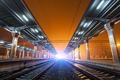 Railway station at night. Train platform in fog. Railroad Royalty Free Stock Photos