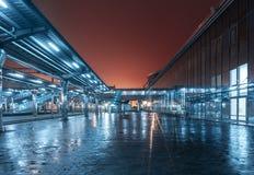 Railway station at night. Train platform in fog. Railroad Royalty Free Stock Photos