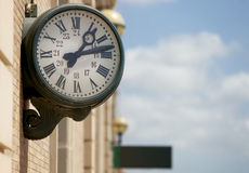 Outdoor analog clock in a railway station Stock Photo