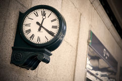 Outdoor analog clock in a railway station Stock Image