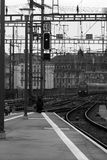 Railway station platform. Black and white photograph of a railway station platform and a train arriving Royalty Free Stock Images