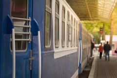 Railway station, platform with an old train vintage wagon. Railway station, platform with an old train car. Vintage wagon Stock Photos