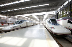 Railway station platforms with 3 high-speed trains Stock Photos
