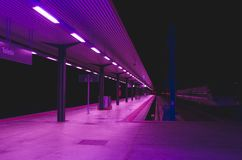 Railway station in purple lighting Royalty Free Stock Photos