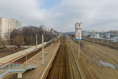 Railway station in Russia and freight and passenger trains Royalty Free Stock Images