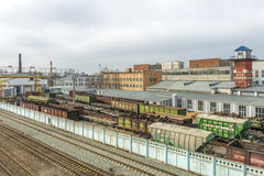 Railway station in Russia and freight and passenger trains Royalty Free Stock Photography