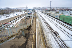 Railway station in Russia and freight and passenger trains Royalty Free Stock Image