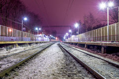 Railway station in Russia and freight and passenger trains Royalty Free Stock Photos