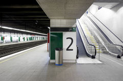 Railway station with signposting platforms and escalators royalty free stock photography
