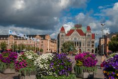 Railway station square in Helsinki at sunny early autumn day. With huge vases with flowers royalty free stock images