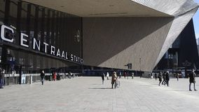 Railway Station with Square Rotterdam. Rotterdam, The Netherlands - March 10, 2017: Modern railway station by architect MVSA in Rotterdam with square and stock video
