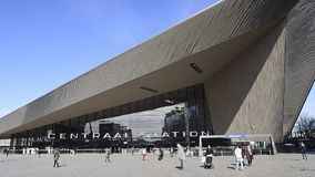 Railway Station and Square in Rotterdam. Rotterdam, The Netherlands - March 10, 2017: Modern railway station by architect MVSA in Rotterdam with square and stock video footage