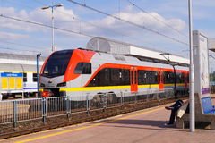 Railway Station - Station Lodz Kaliska - Train carrying passengers Stock Photos