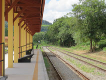 Railway station in sunny day. Awaiting the arrival of the train in a small and wooded railway station of the interior, in a sunny day Stock Image
