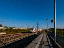Railway Station with a fast train royalty free stock photos